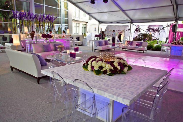 Purple floral decor on party table