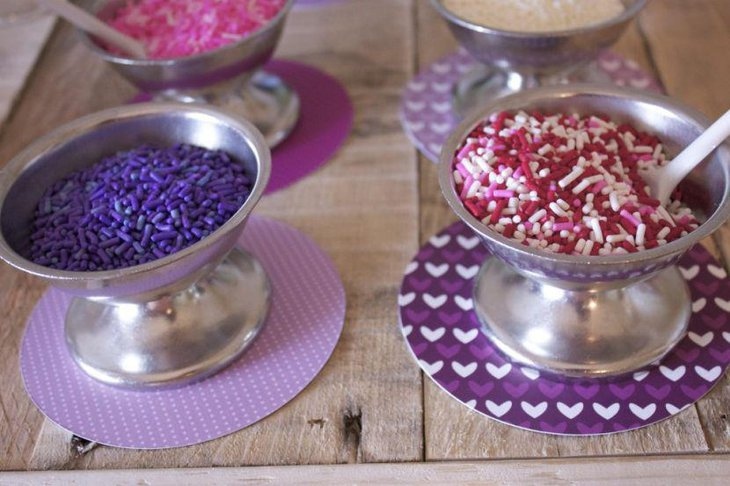 Purple table decor on kids birthday candy table