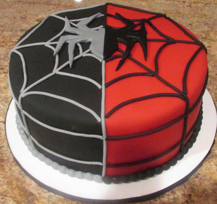 Red and black Spiderman cake with spider web
