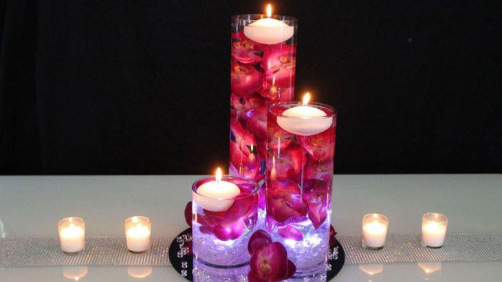 Red and white accented floating candle wedding table centerpiece