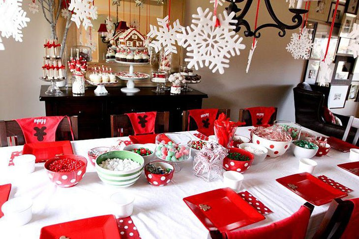 Red and white themed Christmas party table decor