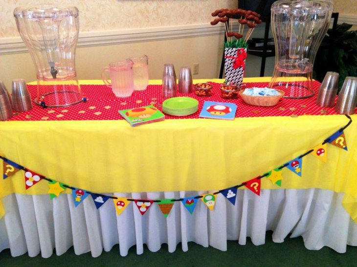Red and yellow accented retirement party table decor