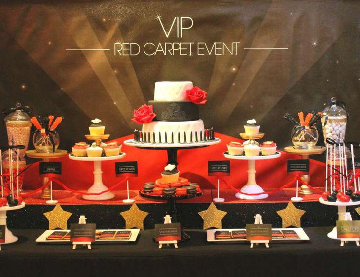 Red Carpet themed dessert table decked in tones of red and gold