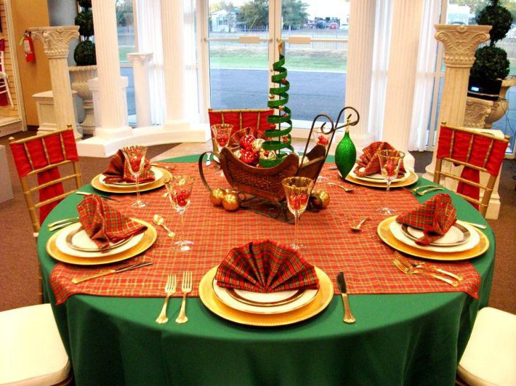 Red checkered tablecloth decorated on the Christmas table