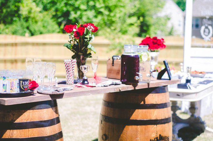 Red floral decor on a bridal shower table