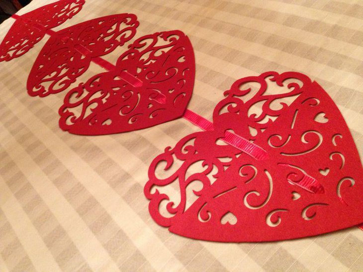 Red heart shaped table mats as Valentines table decor
