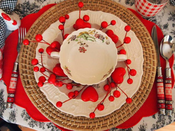 Red hearts and cherry decorations on Valentines table