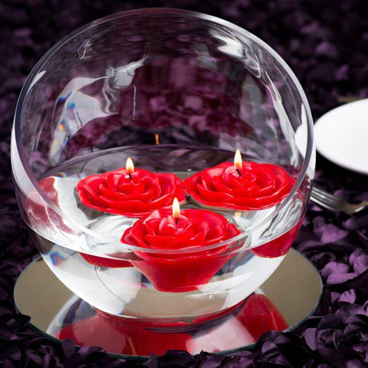 Red rose floating candles centerpiece on Valentines table