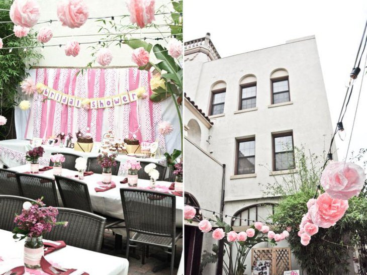 Romantic floral decor displayed on the outdoor bridal shower tables