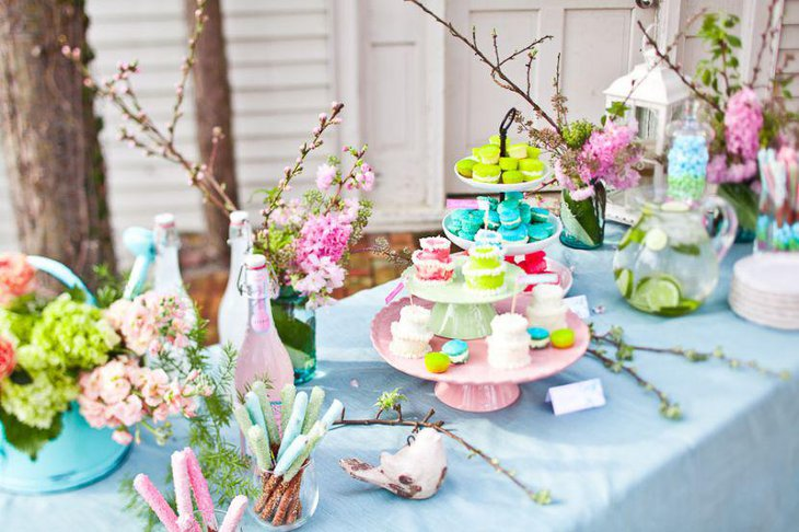 Romantic tablscape on this garden inspired bridal shower sweets table