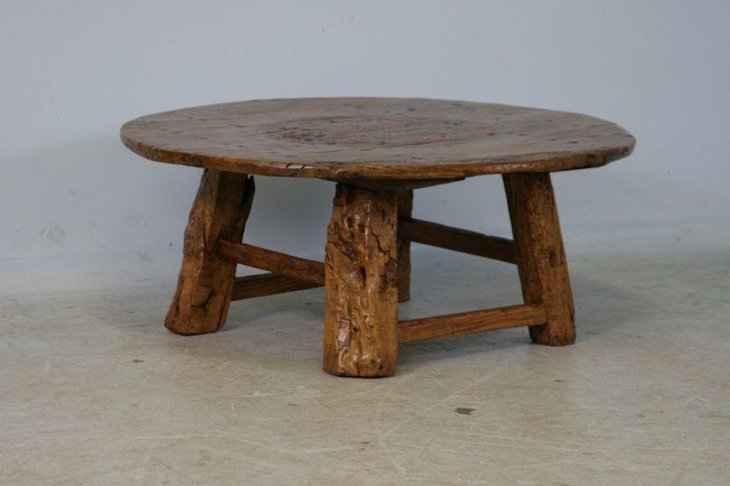 Round rustic coffee table with uneven legs