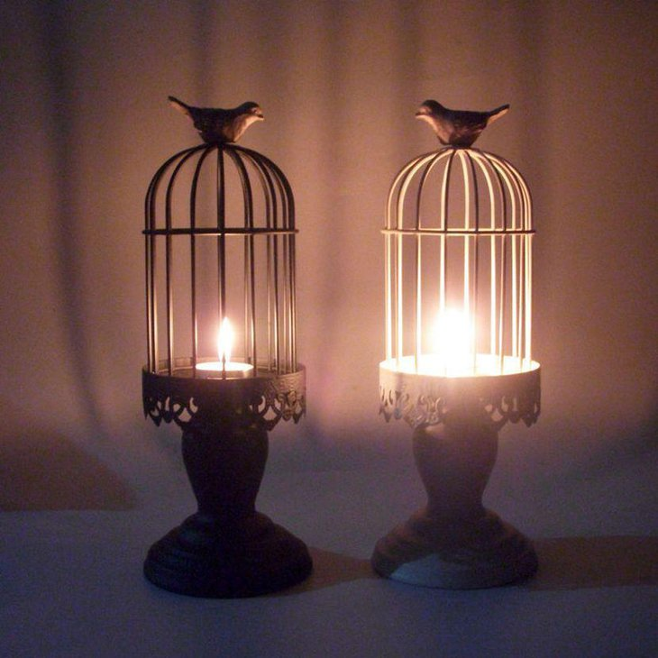 Rustic birdacage candle centerpiece on wedding table