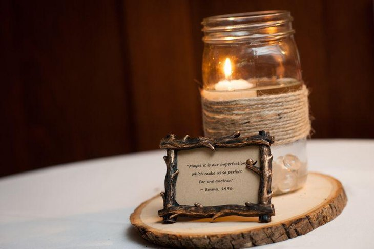 Rustic mason jar with candle centerpiece on wedding table