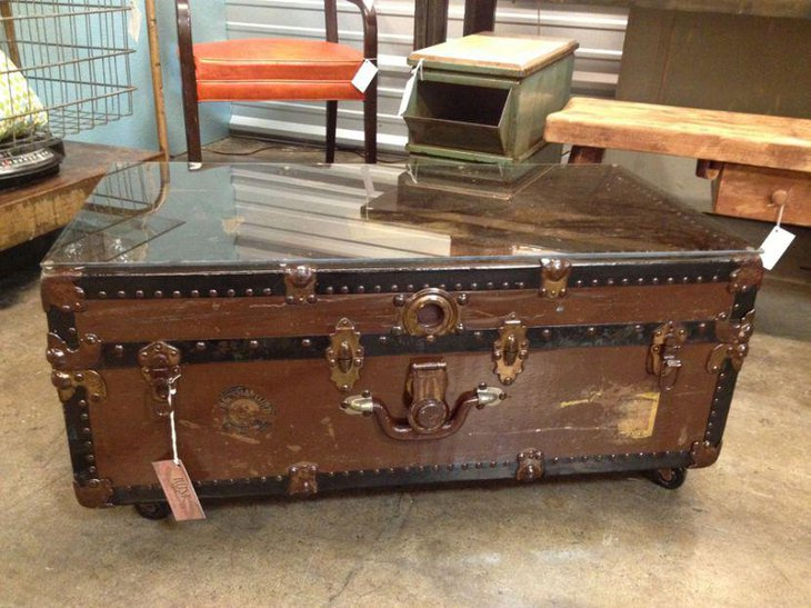 Rustic trunk coffee table with glass top