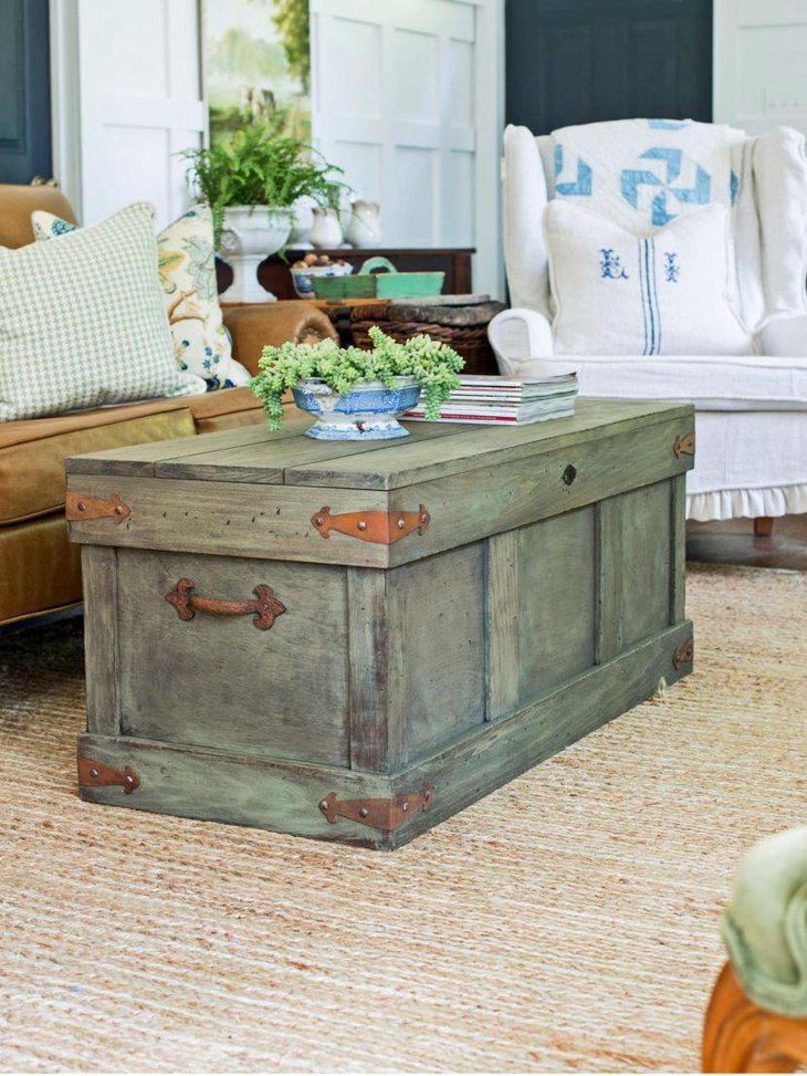 Rustic trunk styled coffee table adds a stylish touch to this living room