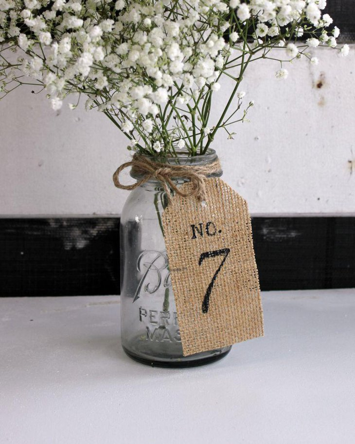 Rustic Wedding Table Burlap and Twine Wrapped Bottle With Flowers