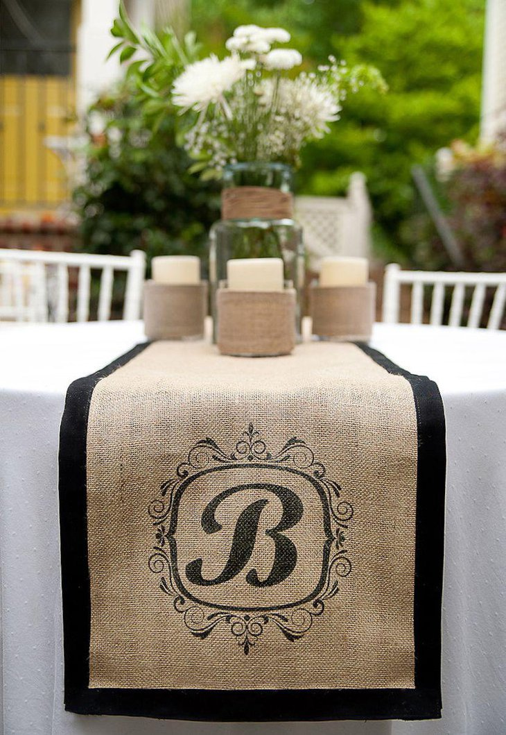 Rustic Wedding Table Centerpiece With Burlap Runner and Twine Wrapped Candles