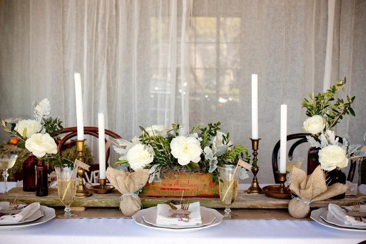 Rustic Wedding Table Ideas with tall candles and beautiful white flowers