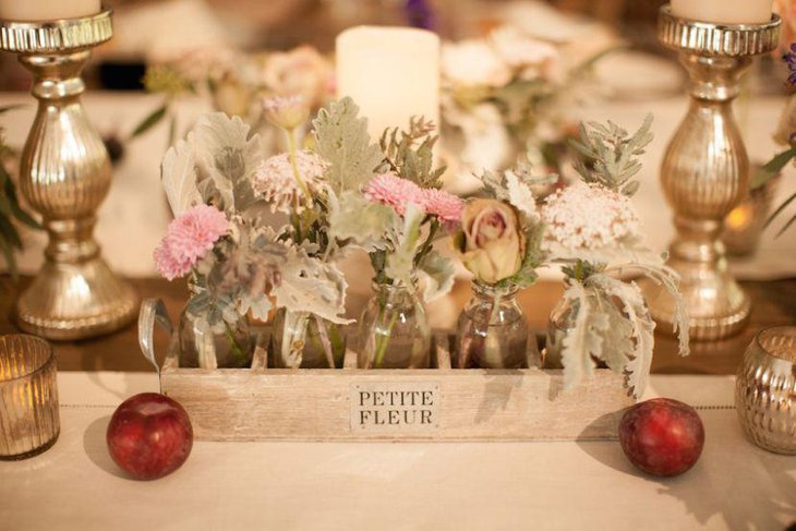 Rustic Wedding Table Setting With Wood Box Centerpiece Filled With Glass Floral Vases and Golden candle Holders