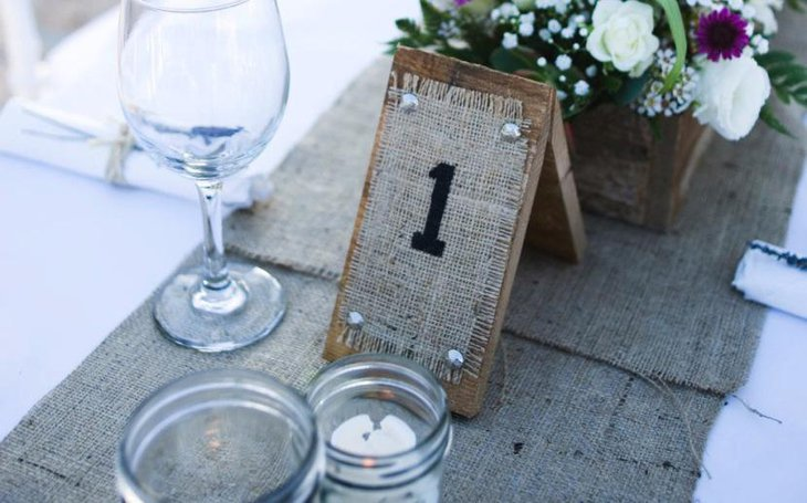 Rustic wood and burlap wedding table