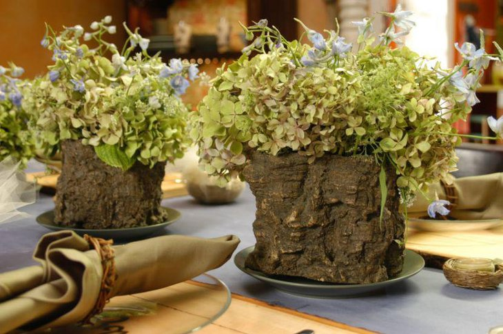 Rustic wooden vases with greens looks fresh