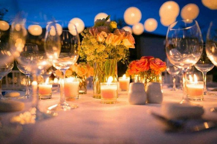 Sassy garden party table decor with candles in votives