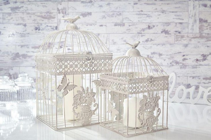 Shabby chic birdcage with white candle wedding table centerpiece