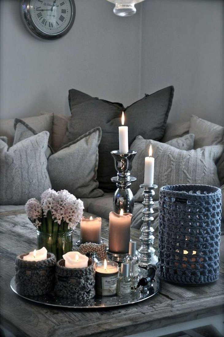 Silver accented candlesticks and tray decoration on coffee table