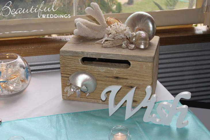Silver decor on treasure chest wedding centerpiece