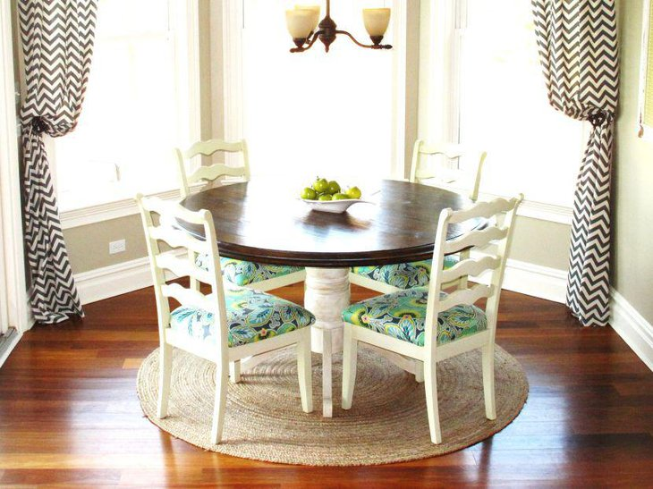 Small breakfast nook table with four chair seating arrangement