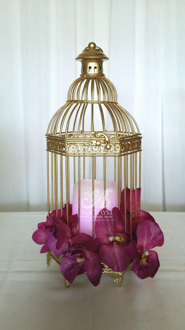 Small golden accented birdcage centerpiece