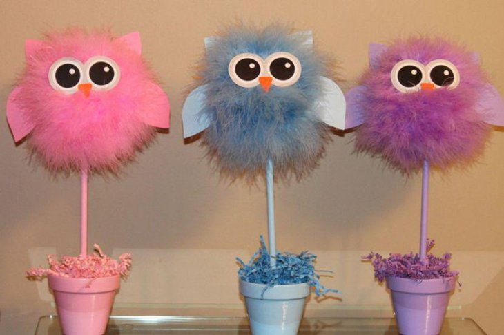 Soft owl centerpieces for a girl baby shower table