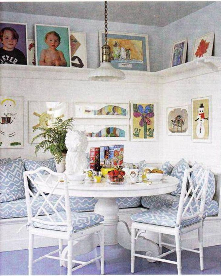 Soothing breakfast nook with open shelving and wall art