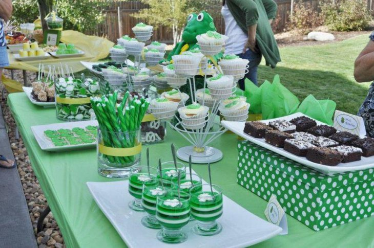 Soothing green dessert table with green colored desserts and eco friendly decoration