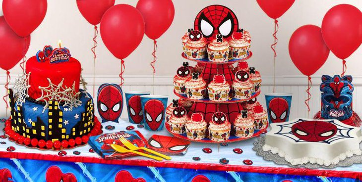 Spiderman dessert table with three tier holder for cupcakes