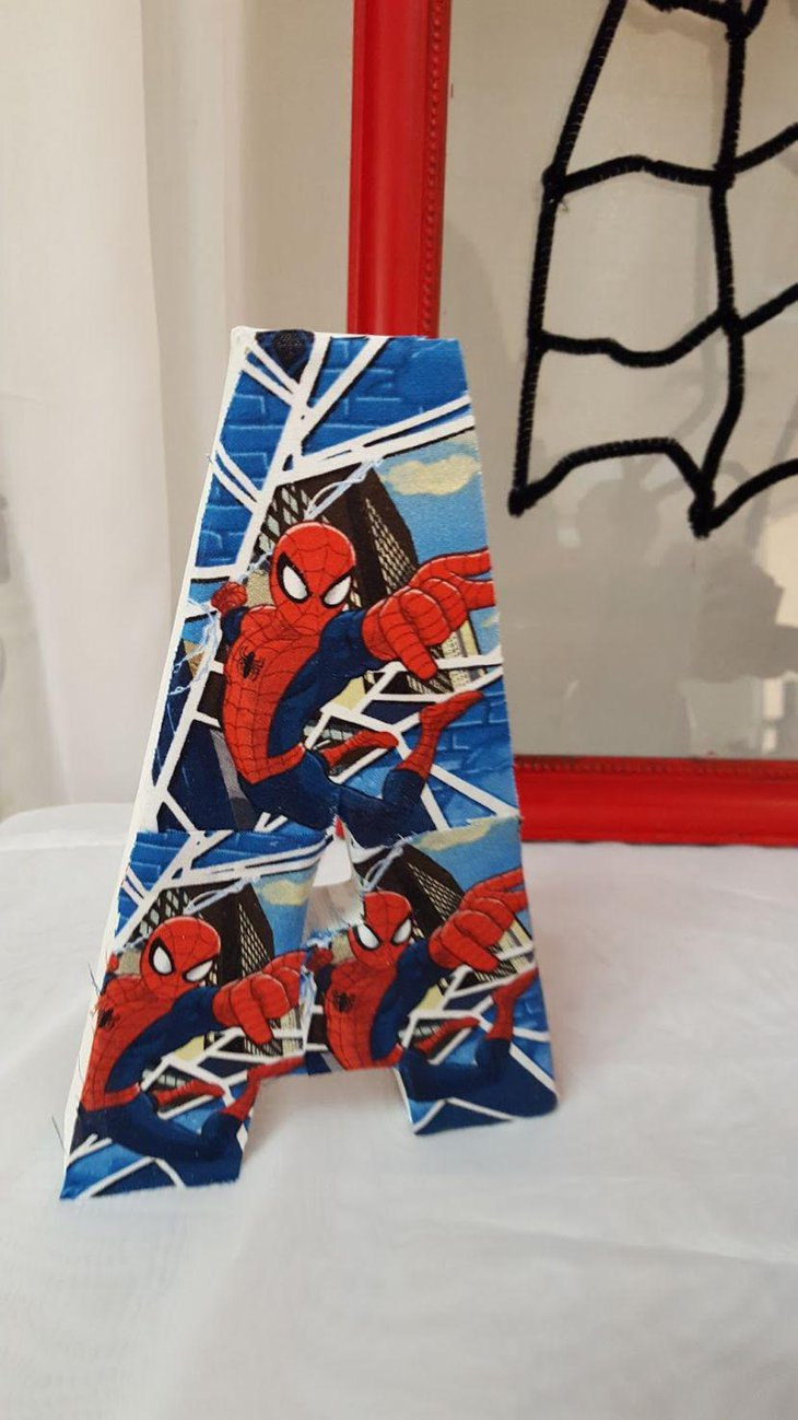 Spiderman theme centerpiece for Spiderman birthday party table