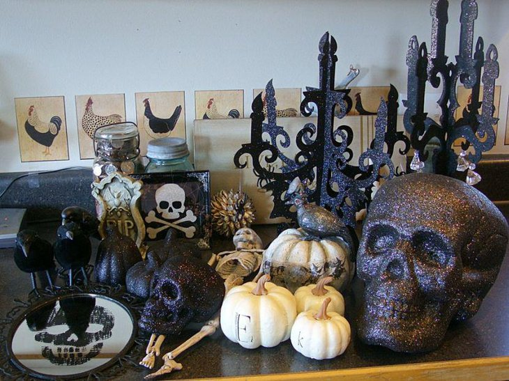 Spooky glittery skulls and pumpkins as Halloween table decorations