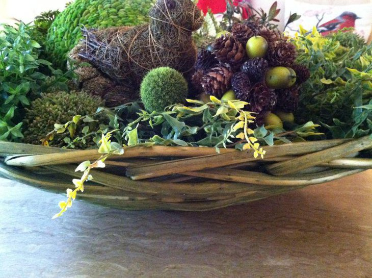 Spring table decor with moss balls and greens