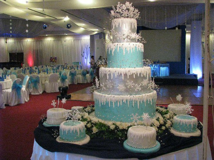 Stunning blue and silver cake decoration with snowflakes on winter table