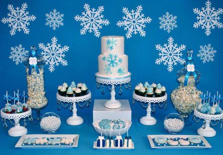Stunning blue candy table idea with snowflakes