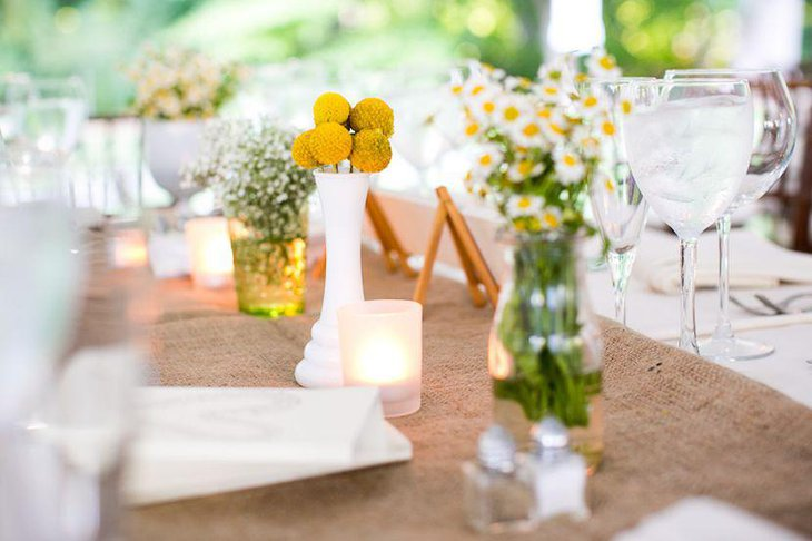 Stunning country wedding table decorated with yellow and white flowers