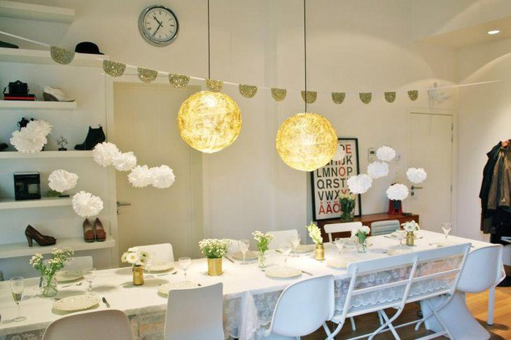 Stunning DIY party table setting with golden metal cans glass jars and fresh flowers