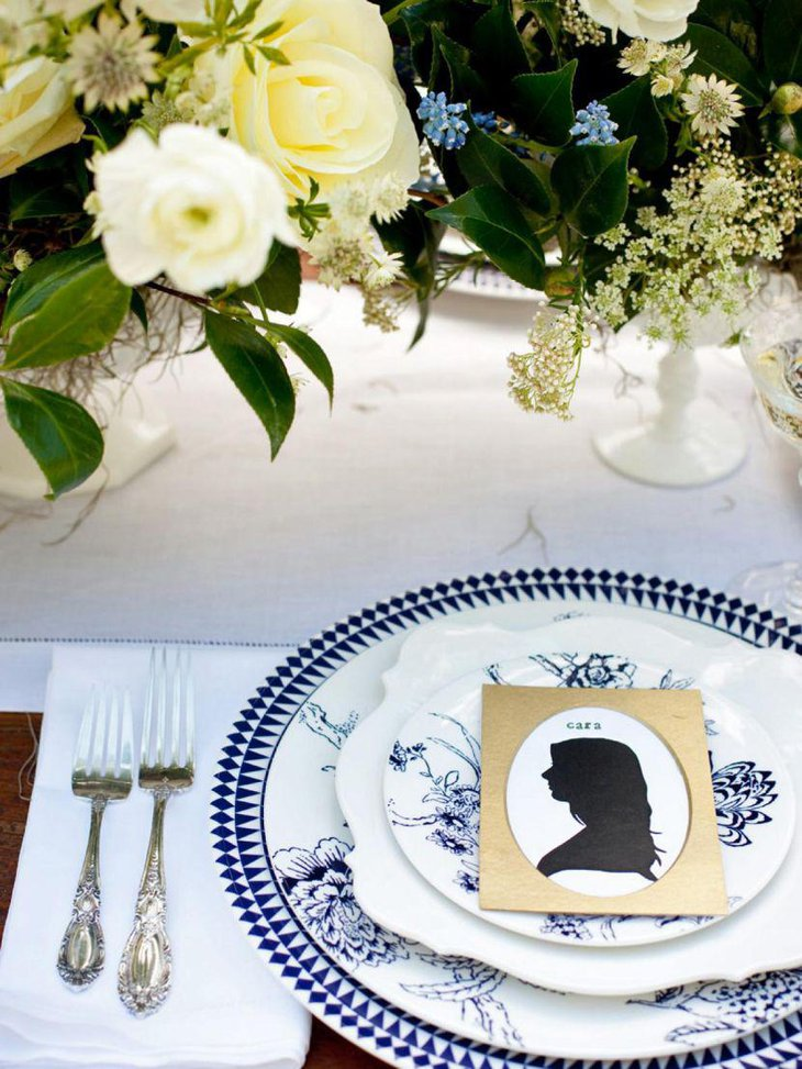 Stunning DIY wedding table decor with silhoutte profile place cards and flowers