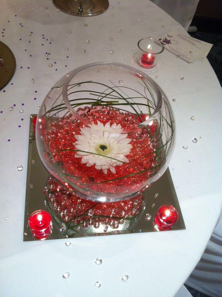 Stunning Fishbowl Wedding Table Centerpiece With Red Beads and Flower