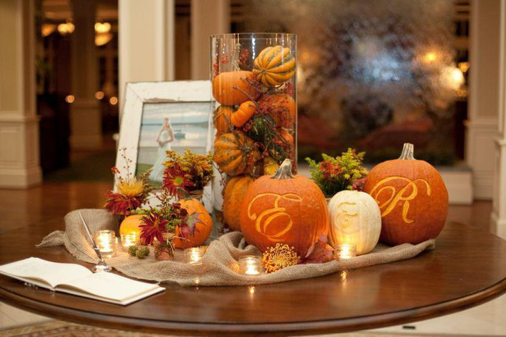 Stunning Halloween table decor with glass jar filled with small pumpkins