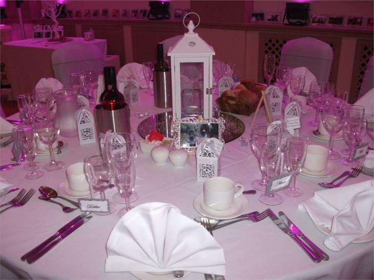 Stunning lantern centerpiece on wedding breakfast table