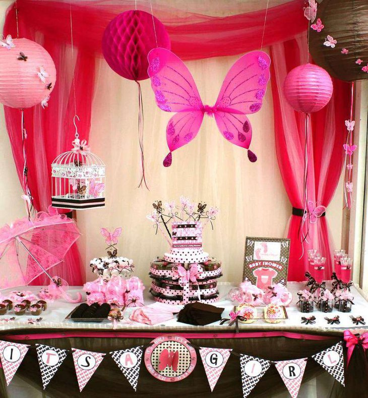 Stunning pink butterfly baby shower tablescape with brown accents