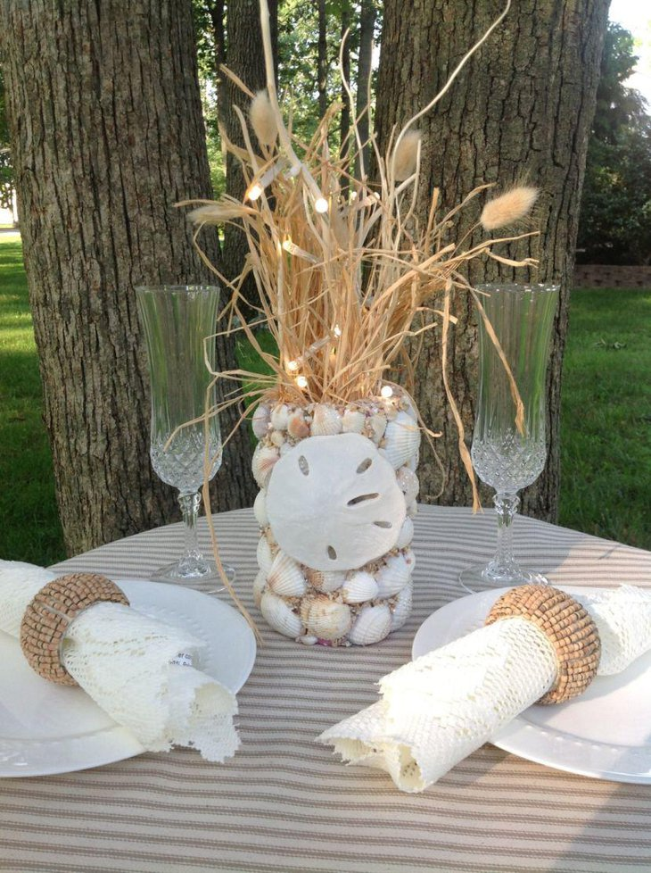 Stunning sea shell wedding table centerpiece