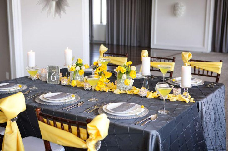 Stunning table set up in grey and yellow for baby shower