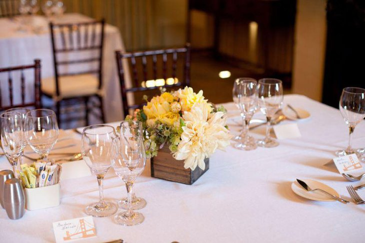 Stunning white and yellow floral centerpiece on birthday table